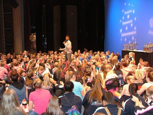 Shawn Byfield speaking with hundreds of dancers
